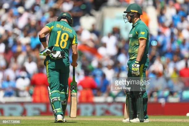 Faf du Plessis and David Miller of South Africa look on after the running out of David Miller during the ICC Champions trophy cricket match between...