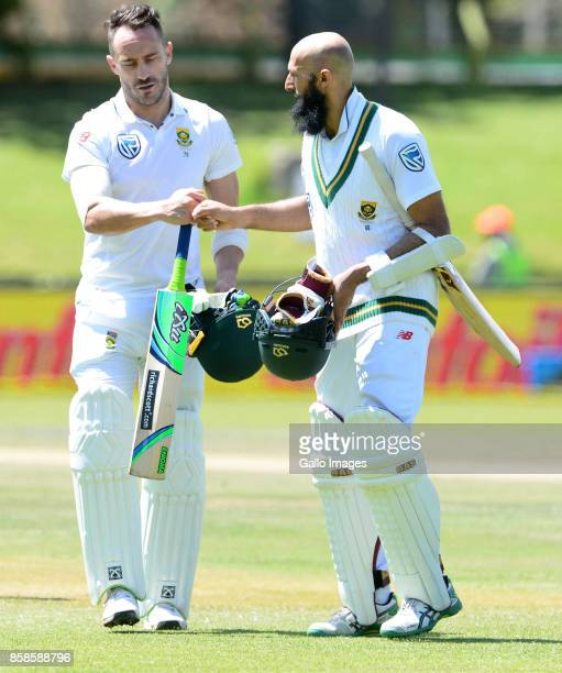 Faf du Plessis and Hashim Amla of the Proteas celebrates their 241 runs partnership during day 2 of the 2nd Sunfoil Test match between South Africa...