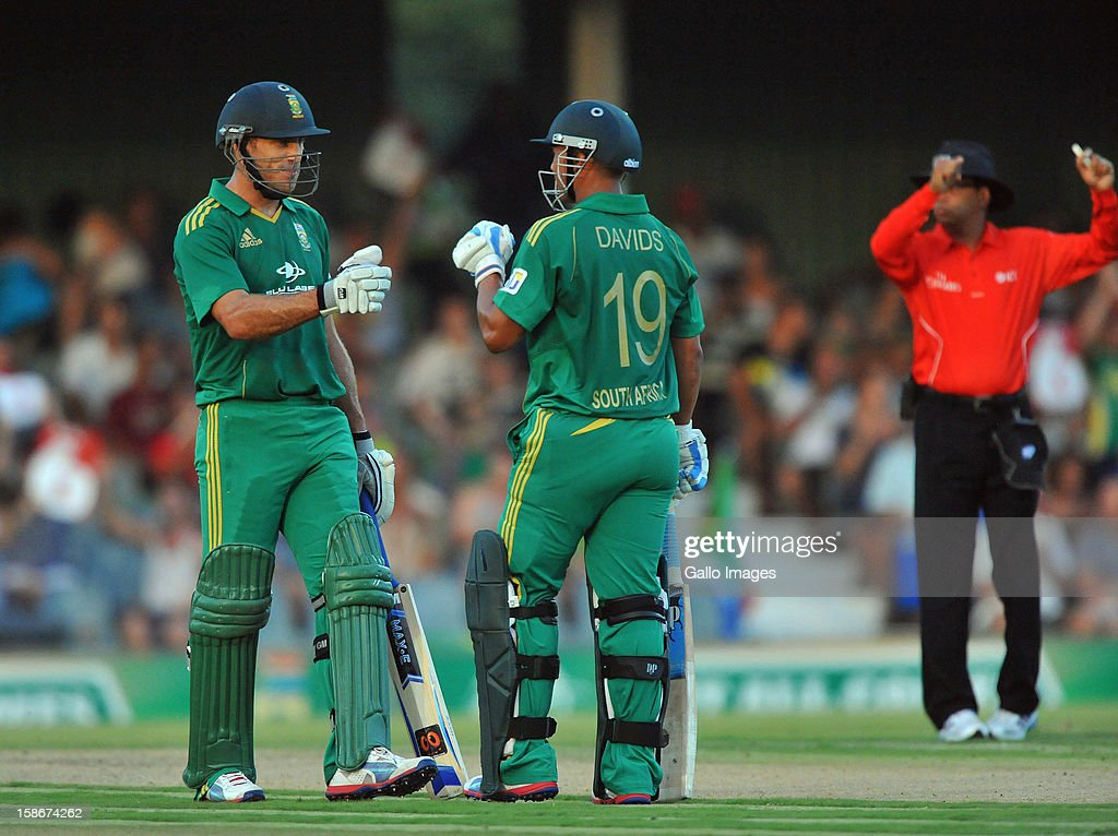 Faf du Plessis and Henry Davids celebrates a six during the 2nd T20 match between South Africa and New Zealand at Buffalo Park on December 23, 2012 in East London, South Africa.