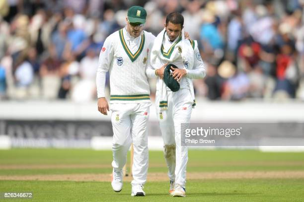 Faf du Plessis and Keshav Maharaj of South Africa leave the field for the lunch break during the 4th Investec Test match between England and South...