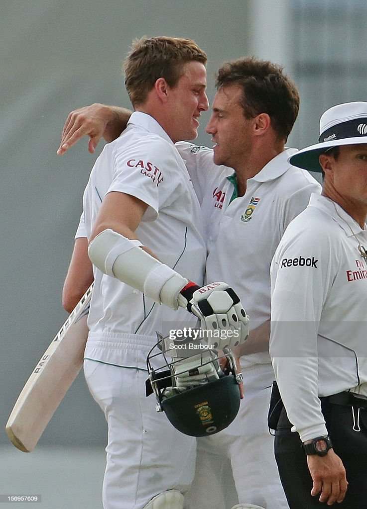 Faf du Plessis and Morne Morkel of South Africa embrace at the conclusion of day five of the Second Test Match between Australia and South Africa at Adelaide Oval on November 26, 2012 in Adelaide, Australia.