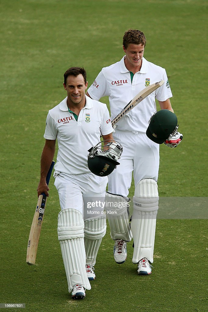 Faf du Plessis and Morne Morkel of South Africa leaves the field after the end of play day five of the Second Test Match between Australia and South Africa at Adelaide Oval on November 26, 2012 in Adelaide, Australia.