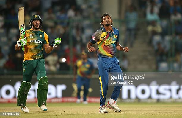 Faf du Plessis Captain of South Africa shows dejection towards referee Sundaram Ravi after being given out LBW during the ICC World Twenty20 India...