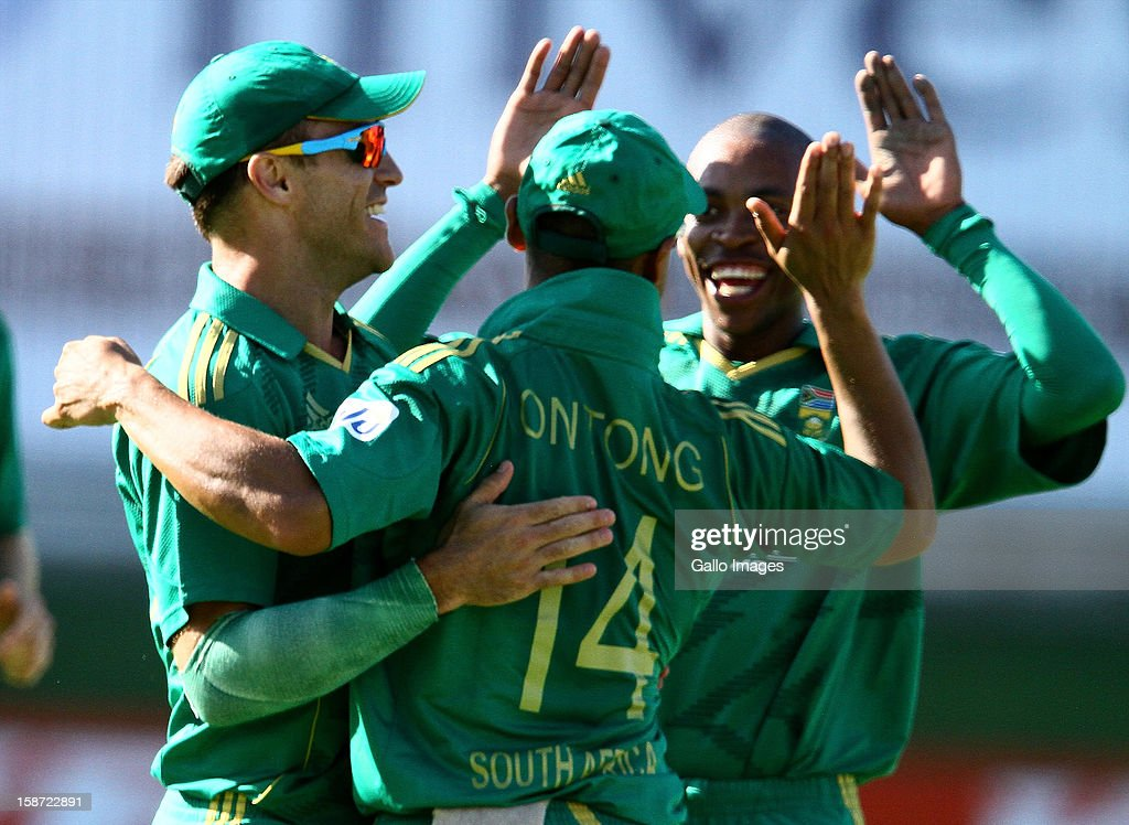 Faf du Plessis, Justin Ontong, and Aaron Phangiso of South Africa celebrate during the 3rd T20 International match between South Africa and New Zealand at AXXESS St Georges on December 26, 2012 in Port Elizabeth, South Africa.