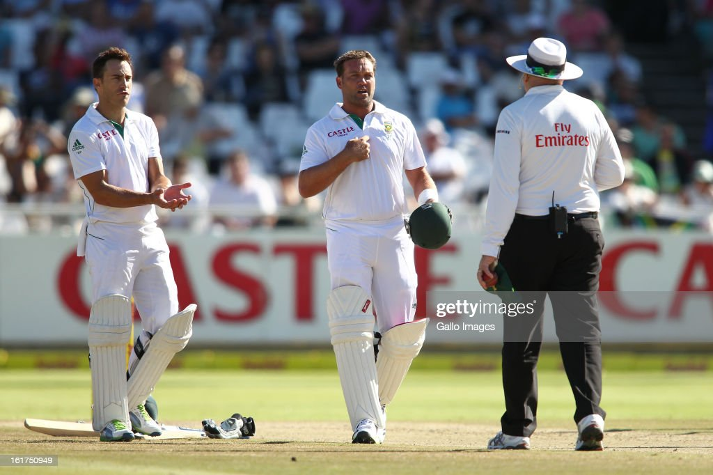 Faf du Plessis of South Africa and Jaques Kallis of South Africa question umpire Steve Davis during day 2 of the 2nd Sunfoil Test match between South Africa and Pakistan at Sahara Park Newlands on February 15, 2013 in Cape Town, South Africa.