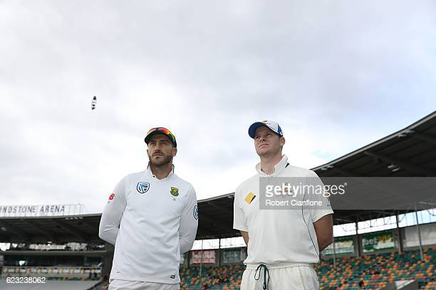 Faf du Plessis of South Africa and Steve Smith of Australia look on after day four of the Second Test match between Australia and South Africa at...