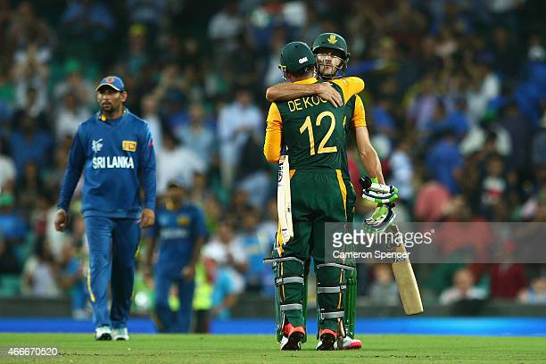 Faf du Plessis of South Africa and team mate Quinton de Kock embrace after winning the 2015 ICC Cricket World Cup match between South Africa and Sri...