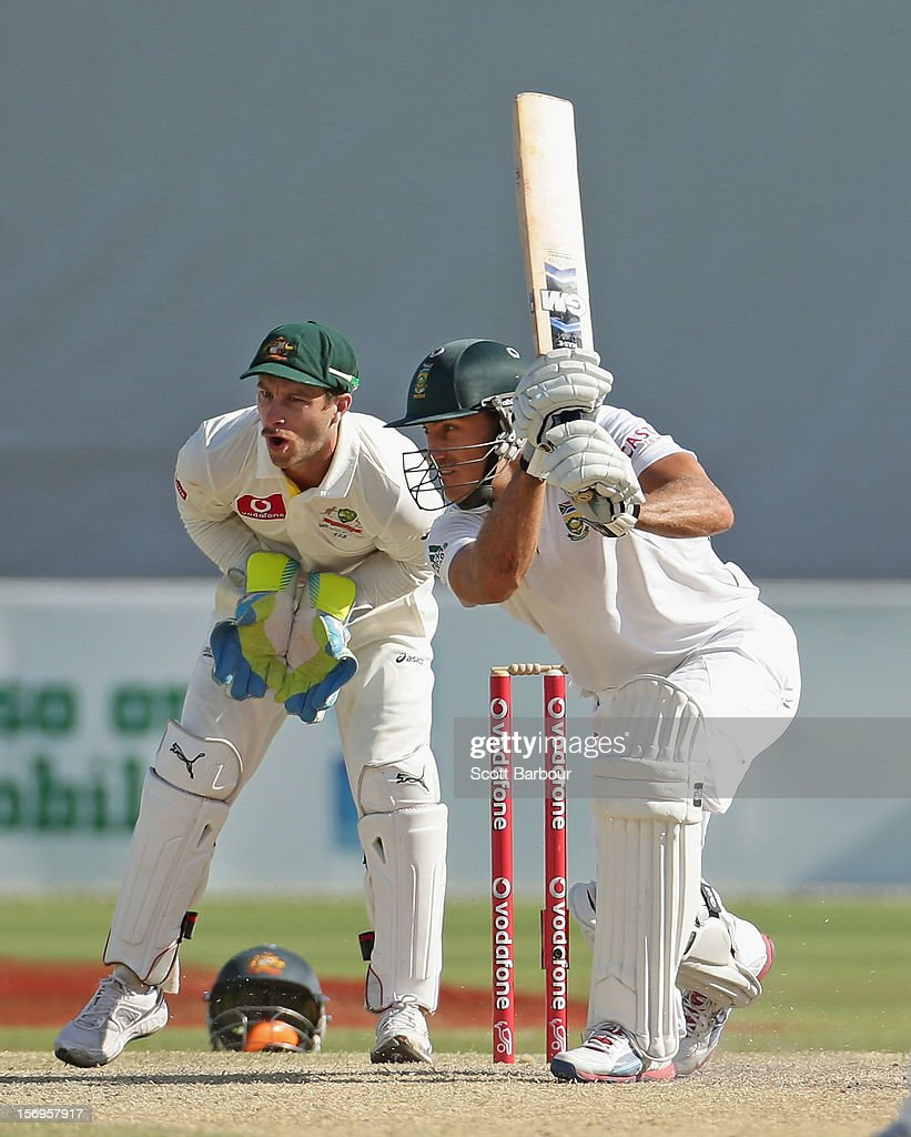 Faf du Plessis of South Africa bats as Matthew Wade of Australia looks on during day five of the Second Test Match between Australia and South Africa at Adelaide Oval on November 26, 2012 in Adelaide, Australia.