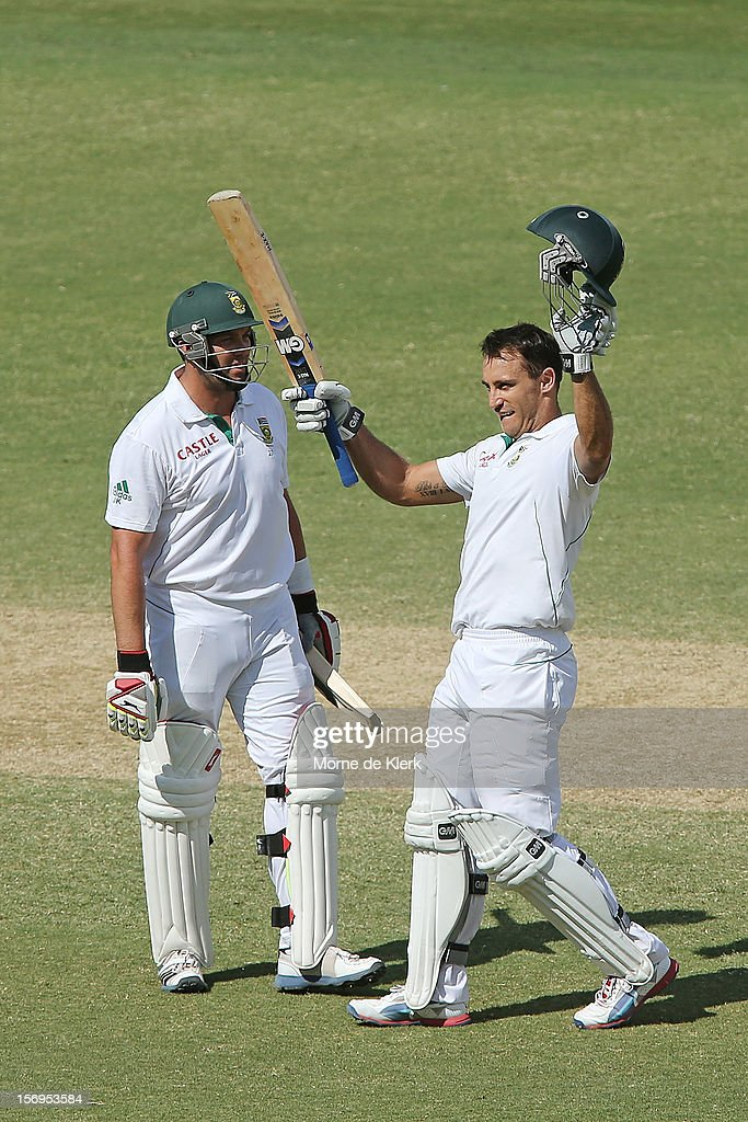 Faf du Plessis (R) of South Africa celebrates after reaching 100 runs during day five of the Second Test Match between Australia and South Africa at Adelaide Oval on November 26, 2012 in Adelaide, Australia.