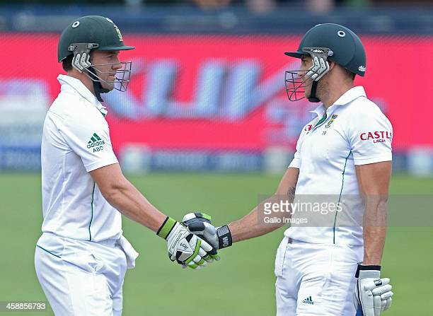 Faf du Plessis of South Africa celebrates his 50 with AB de Villiers during day 5 of the 1st Test match between South Africa and India at Bidvest...