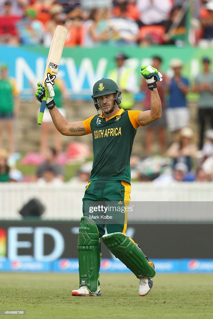 Faf du Plessis of South Africa celebrates his century during the 2015 ICC Cricket World Cup match between South Africa and Ireland at Manuka Oval on March 3, 2015 in Canberra, Australia.