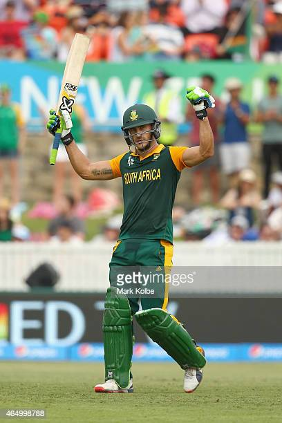 Faf du Plessis of South Africa celebrates his century during the 2015 ICC Cricket World Cup match between South Africa and Ireland at Manuka Oval on...