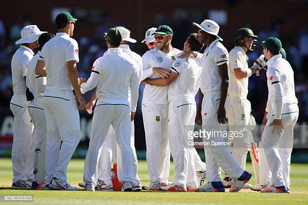 Faf du Plessis of South Africa congratulates Tabraiz Shamsi of South Africa following a DRS review dismissing Usman Khawaja of Australia for lbw...