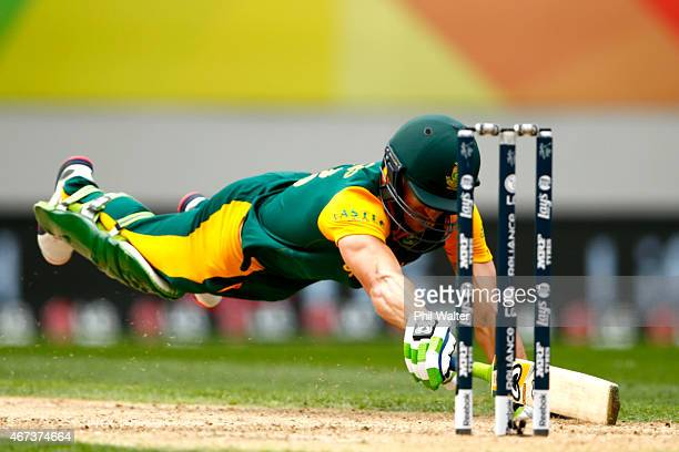 Faf du Plessis of South Africa dives to make his crease during the 2015 Cricket World Cup Semi Final match between New Zealand and South Africa at...