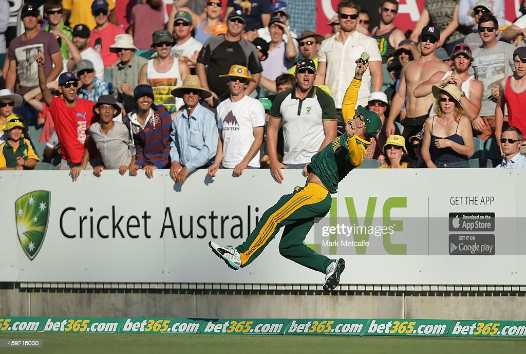 Faf du Plessis of South Africa dives to stop a six during game three of the One Day International Series between Australia and South Africa at Manuka Oval on November 19, 2014 in Canberra, Australia.
