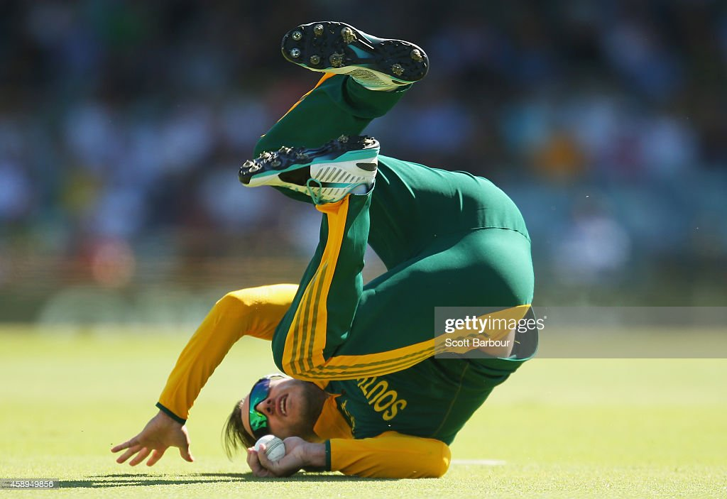 Faf du Plessis of South Africa dives to take a catch to dismiss Glenn Maxwell of Australia during game one of the men's one day international series between Australia and South Africa at WACA on November 14, 2014 in Perth, Australia.