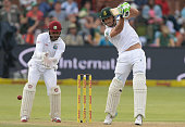 Faf du Plessis of South Africa drives off the back foot during day 1 of the 2nd Test match between South Africa and West Indies at St Georges Park on...