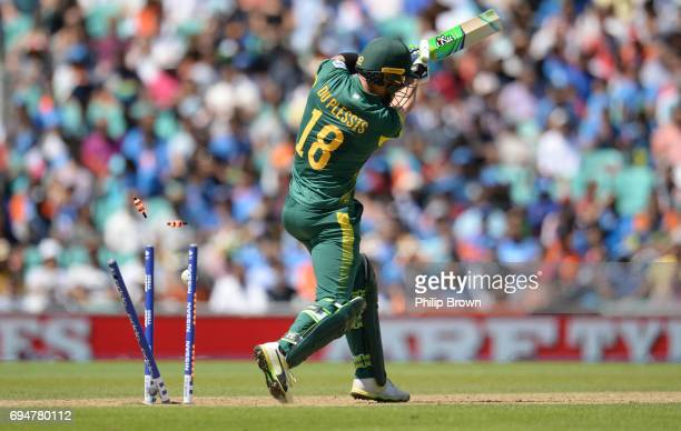 Faf du Plessis of South Africa is bowled during the ICC Champions Trophy match between India and South Africa at the Kia Oval cricket ground on June...