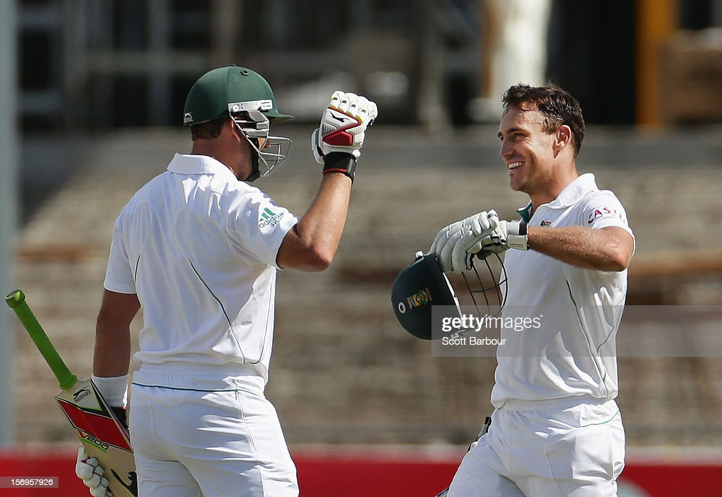 Faf du Plessis of South Africa is congratulated by Jacques Kallis of South Africa after reaching his century during day five of the Second Test Match between Australia and South Africa at Adelaide Oval on November 26, 2012 in Adelaide, Australia.