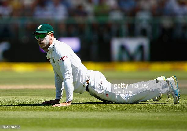 Faf du Plessis of South Africa miss fields as he looks on during day one of the 2nd Test at Newlands Stadium on January 2 2016 in Cape Town South...