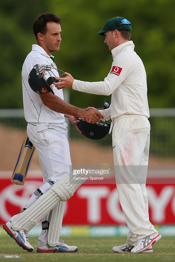Faf du Plessis of South Africa shakes hands with Australian captain Michael Clarke following play on day five of the Second Test Match between Australia and South Africa at Adelaide Oval on November 26, 2012 in Adelaide, Australia.