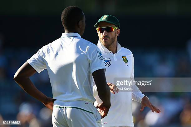 Faf du Plessis of South Africa talks with Kagiso Rabada of South Africa during day four of the First Test match between Australia and South Africa at...