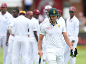 Faf du Plessis of South Africa walks off for 103 runs during day 2 of the 2nd Test match between South Africa and West Indies at St Georges Park on...