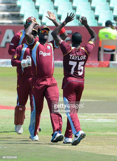 Faf du Plessis of South Africa with his team mate during the 1st Momentum ODI between South Africa and West Indies at Sahara Stadium Kingsmead on...