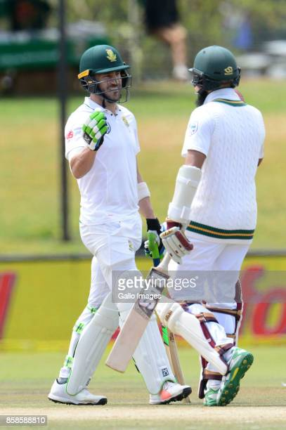 Faf du Plessis of the Proteas celebrates his 100 runs with Hashim Amla of the Proteas during day 2 of the 2nd Sunfoil Test match between South Africa...