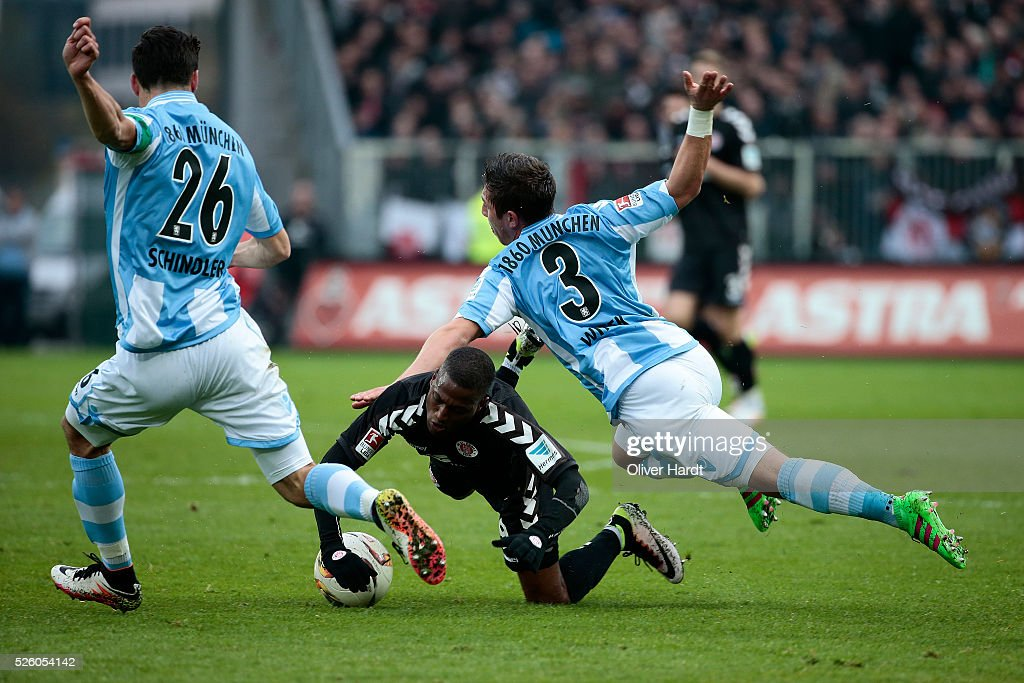 Fafa Picault (C) of Hamburg and Maximilan Wittek (R) of Muenchen compete for the ball during the Second Bundesliga match between FC St. Pauli and 1860 Muenchen at Millerntor Stadium on April 29, 2016 in Hamburg, Germany.