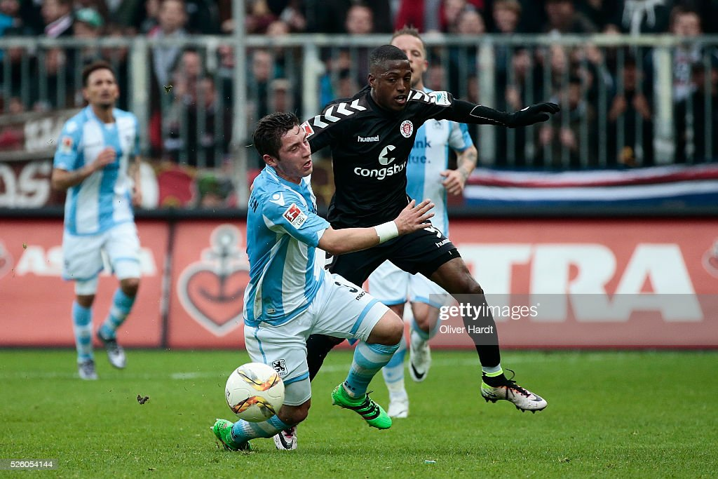 Fafa Picault (R) of Hamburg and Maximilan Wittek (L) of Muenchen compete for the ball during the Second Bundesliga match between FC St. Pauli and 1860 Muenchen at Millerntor Stadium on April 29, 2016 in Hamburg, Germany.