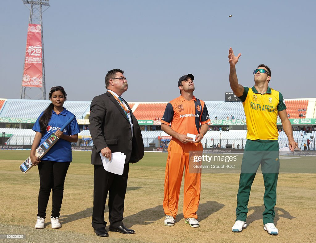 Faff Du Plessis captain of South Africa tosses the coin with Peter Borren captain of The Netherlands match referee David Boon and Pepsi mascot...