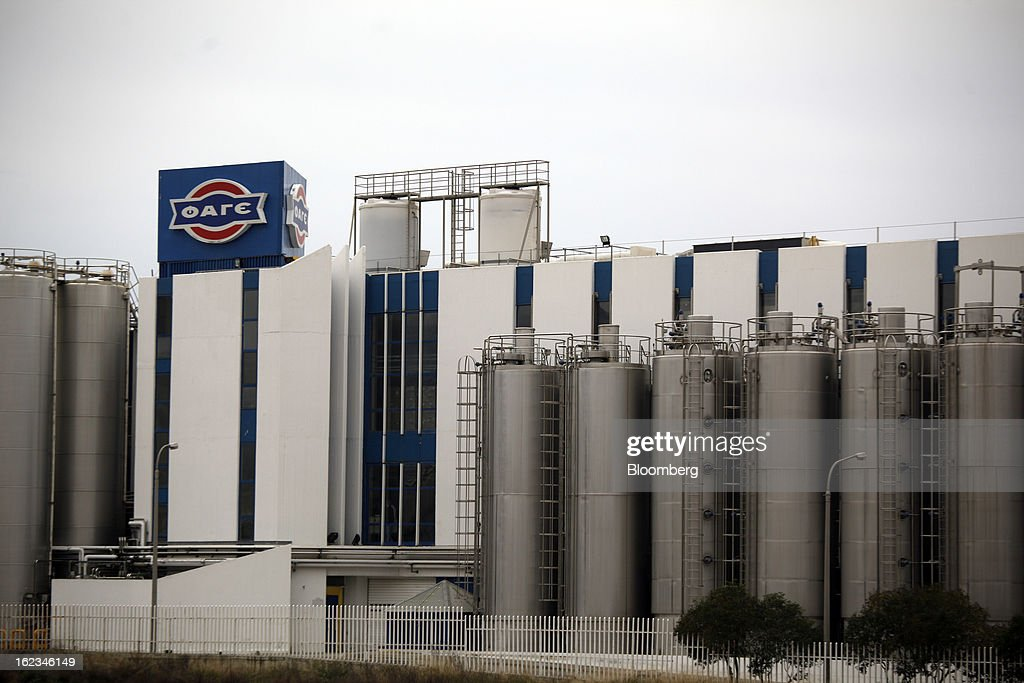 A Fage logo stands on display outside the Fage Dairy Industry SA plant in Athens, Greece, on Thursday, Feb. 21, 2013. An October restructuring that placed Fage International SA's Greek units in a subsidiary called Fage Dairy Industry SA coincided with Coca-Cola Hellenic Bottling SA's plan to flee the epicenter of Europe's debt crisis by moving its main stock listing to London from Athens. Photographer: Kostas Tsironis/Bloomberg via Getty Images