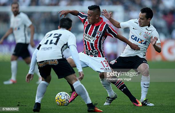 Fagner and Rodriguinho of Corinthians fights for the ball with Cueva of Sao Paulo during the match between Corinthians and Sao Paulo for the...