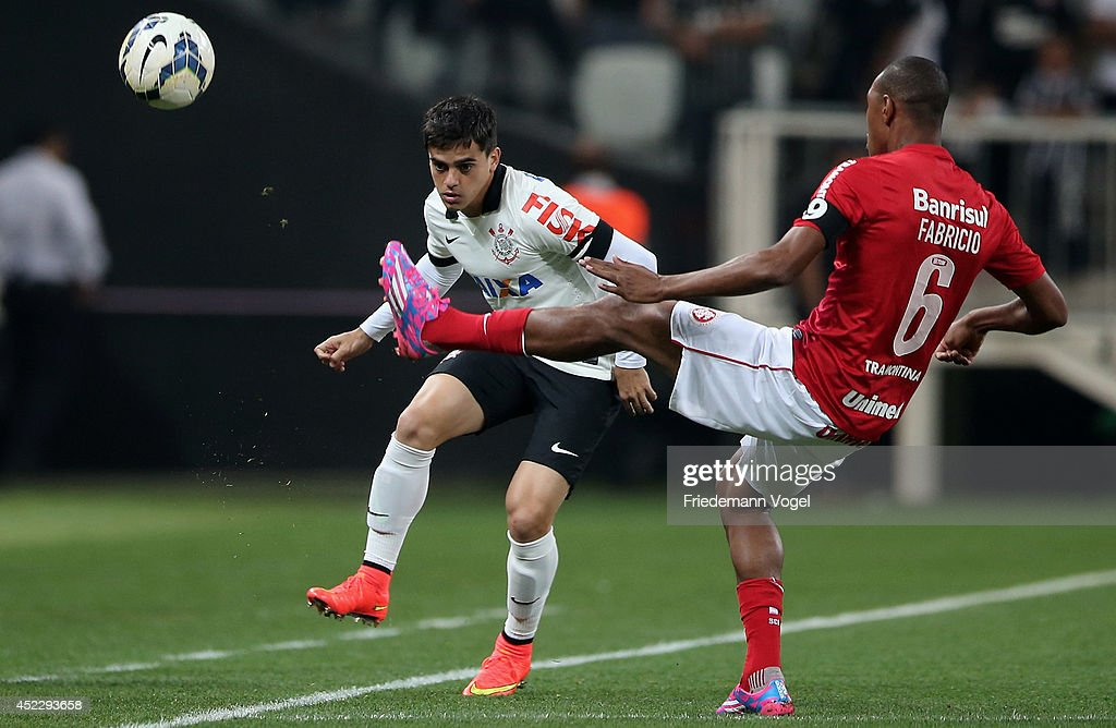 Fagner of Corinthians fights for the ball with Fabricio of Internacional during the match between Corinthians and Internacional for the Brazilian Series A 2014 at Arena Corinthians on July 17, 2014 in Sao Paulo, Brazil.