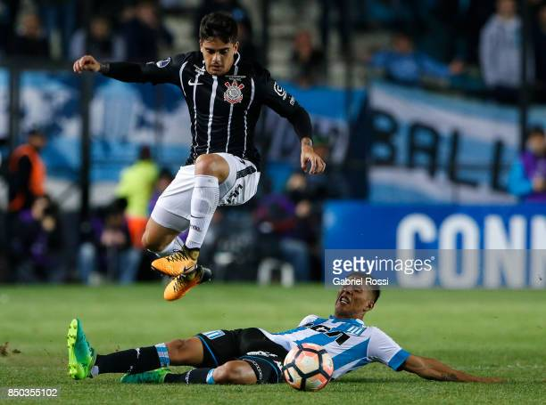 Fagner of Corinthians jumps over Matias Zaracho of Racing Club during a second leg match between Racing Club and Corinthians as part of round of 16...