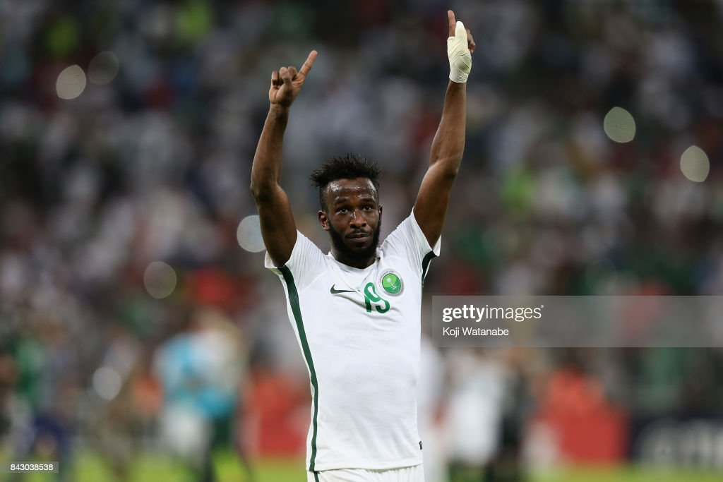 Fahad Al Muwallad of Saudi Arabia applauds supporters after his side's 1-0 victory and qualified for the FIFA World Cup Russia after the FIFA World Cup qualifier match between Saudi Arabia and Japan at the King Abdullah Sports City on September 5, 2017 in Jeddah, Saudi Arabia.