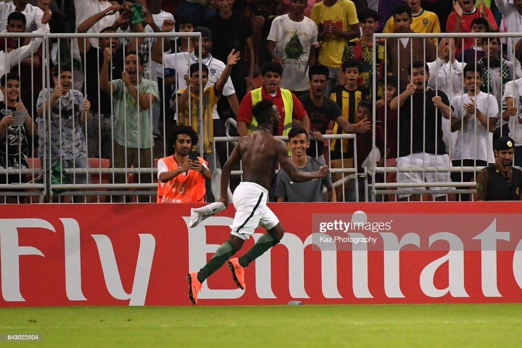 Fahad Al Muwallad of Saudi Arabia celebrates scoring the opening goal during the FIFA World Cup qualifier match between Saudi Arabia and Japan at the King Abdullah Sports City on September 5, 2017 in Jeddah, Saudi Arabia.