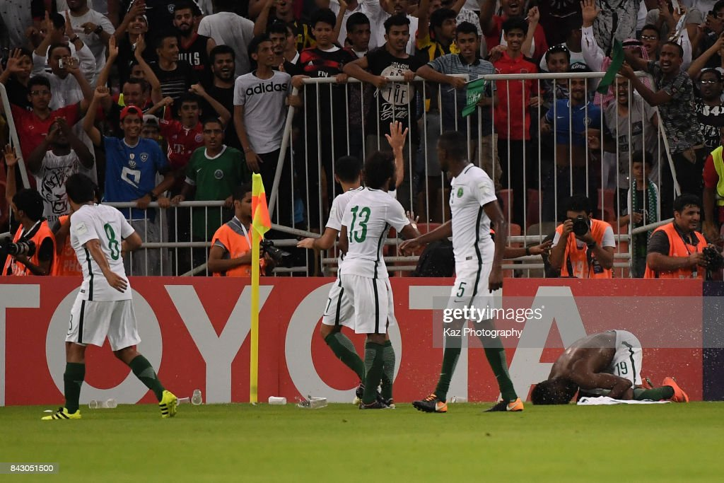 Fahad Al Muwallad (1st R) of Saudi Arabia celebrates scoring the opening goal during the FIFA World Cup qualifier match between Saudi Arabia and Japan at the King Abdullah Sports City on September 5, 2017 in Jeddah, Saudi Arabia.
