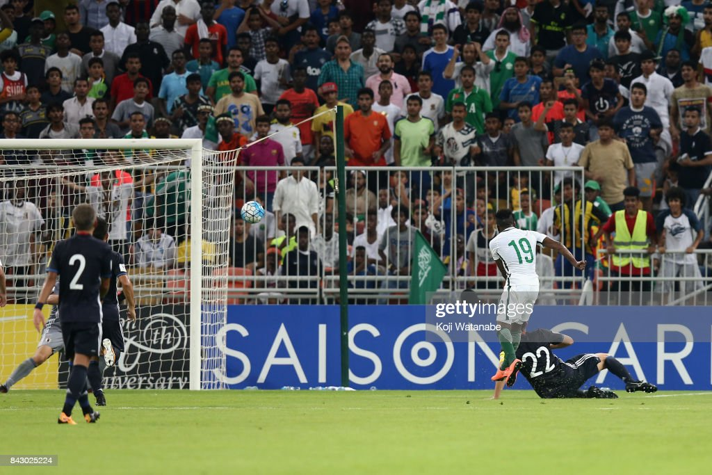 Fahad Al Muwallad of Saudi Arabia scores the opening goal during the FIFA World Cup qualifier match between Saudi Arabia and Japan at the King Abdullah Sports City on September 5, 2017 in Jeddah, Saudi Arabia.