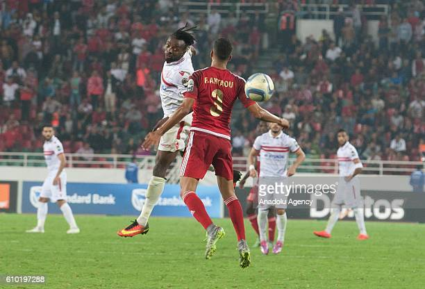 Fahd Aktaou of Wydad Casablanca and Stanley Ohawuchi of Zamalek vie for the ball during the semifinal match of CAF Champions League between Wydad...