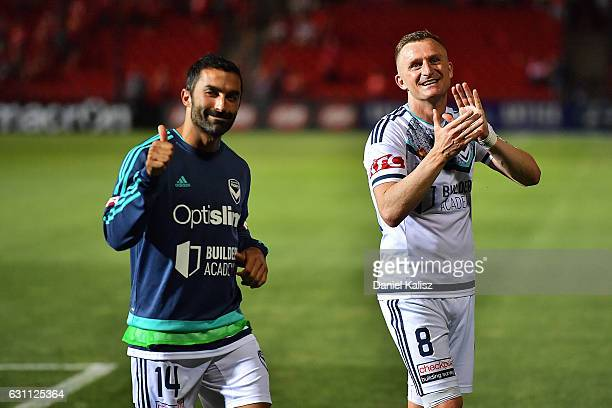 Fahid Ben Khalfallah and Besart Berisha of the Victory react to the crowd after the round 14 ALeague match between Adelaide United and Melbourne...