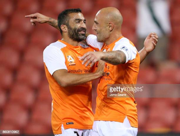Fahid Ben Khalfallah and Massimo Maccarone of Brisbane celebrate a goal during the round two ALeague match between the Brisbane Roar and Adelaide...