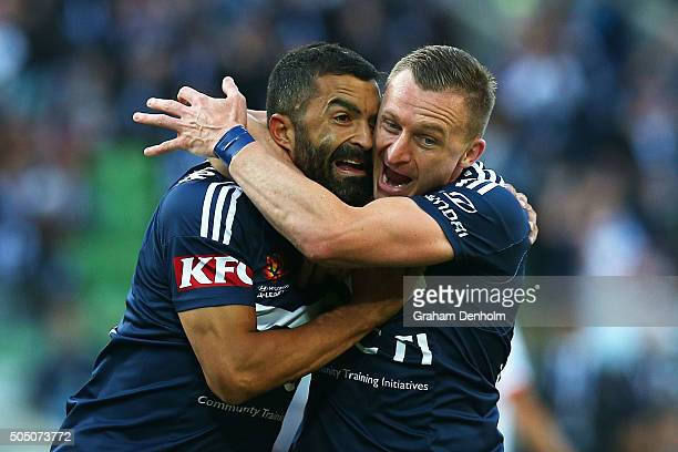 Fahid Ben Khalfallah of Melbourne Victory and Besart Berisha of Melbourne Victory celebrate a goal during the round 15 ALeague match Melbourne...