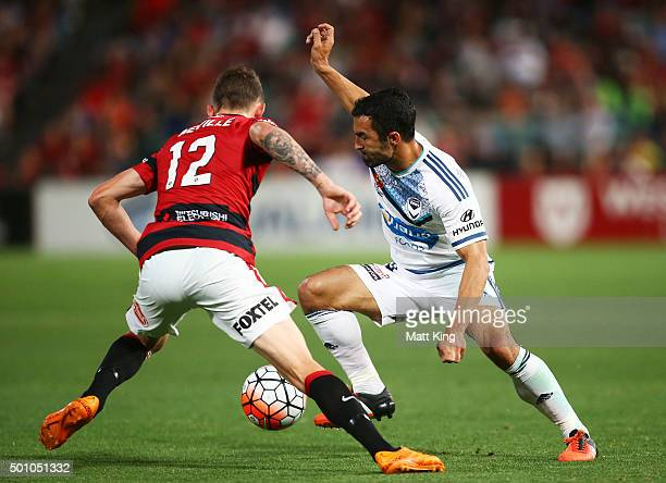 Fahid Ben Khalfallah of Melbourne Victory is challenged by Scott Neville of the Wanderers during the round 10 ALeague match between the Western...