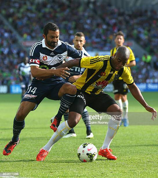 Fahid Ben Khalfallah of the Victory and Rolieny Bonevacia of the Phoenix contest for the ball during the round 19 ALeague match between the Melbourne...