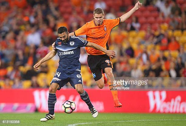 Fahid Ben Khalfallah of the Victory and Thomas Kristensen of the Roar compete for the ball during the round one ALeague match between the Brisbane...