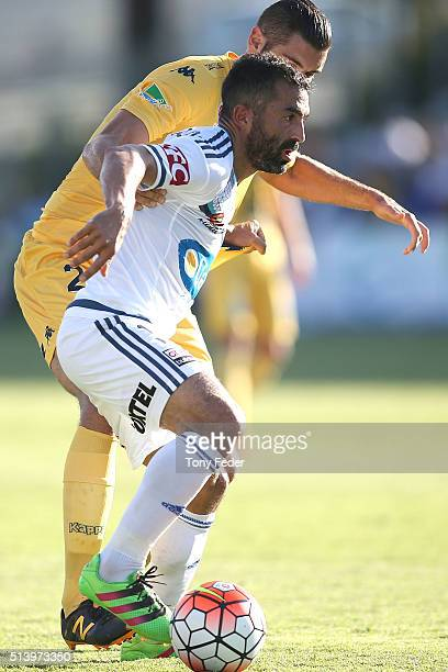 Fahid Ben Khalfallah of the Victory contests the ball with his Mariners opponent during the round 22 ALeague match between the Central Coast Mariners...