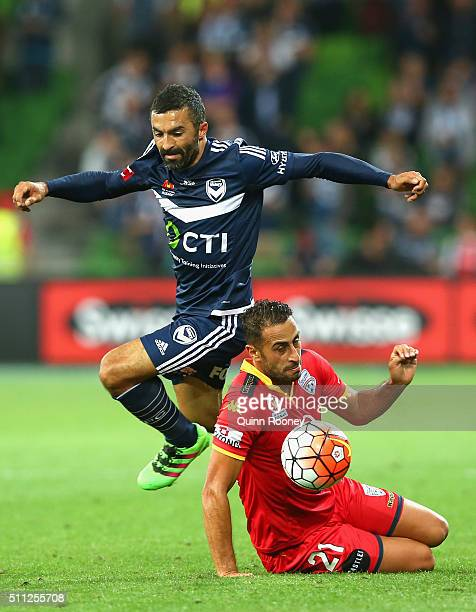 Fahid Ben Khalfallah of the Victory is tackled by Tarek Elrich of United during the round 20 ALeague match between Melbourne Victory and Adelaide...