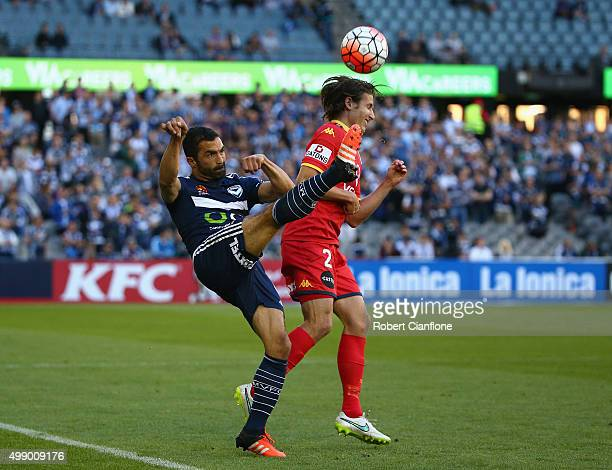 Fahid Ben Khalfallah of the Victory kicks the ball away from Michael Marrone of Adelaide United during the round eight ALeague match between...